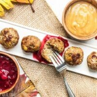 Turkey and Stuffing Meatballs dipped in cranberry sauce and gravy.