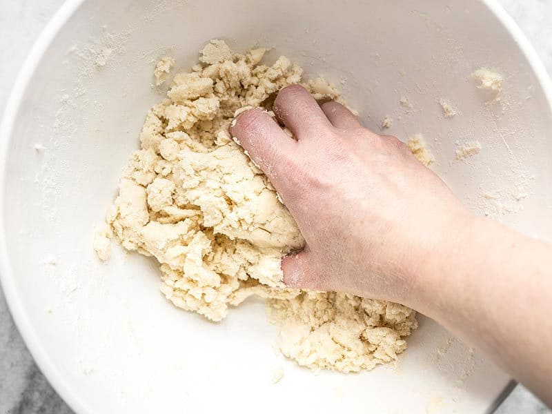 Use Hands to Form Pecan Pie Dough
