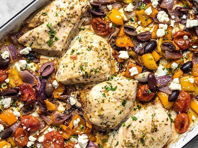 Add olives, parsley, and lemon zest to Sheet Pan Greek Chicken and Vegetables