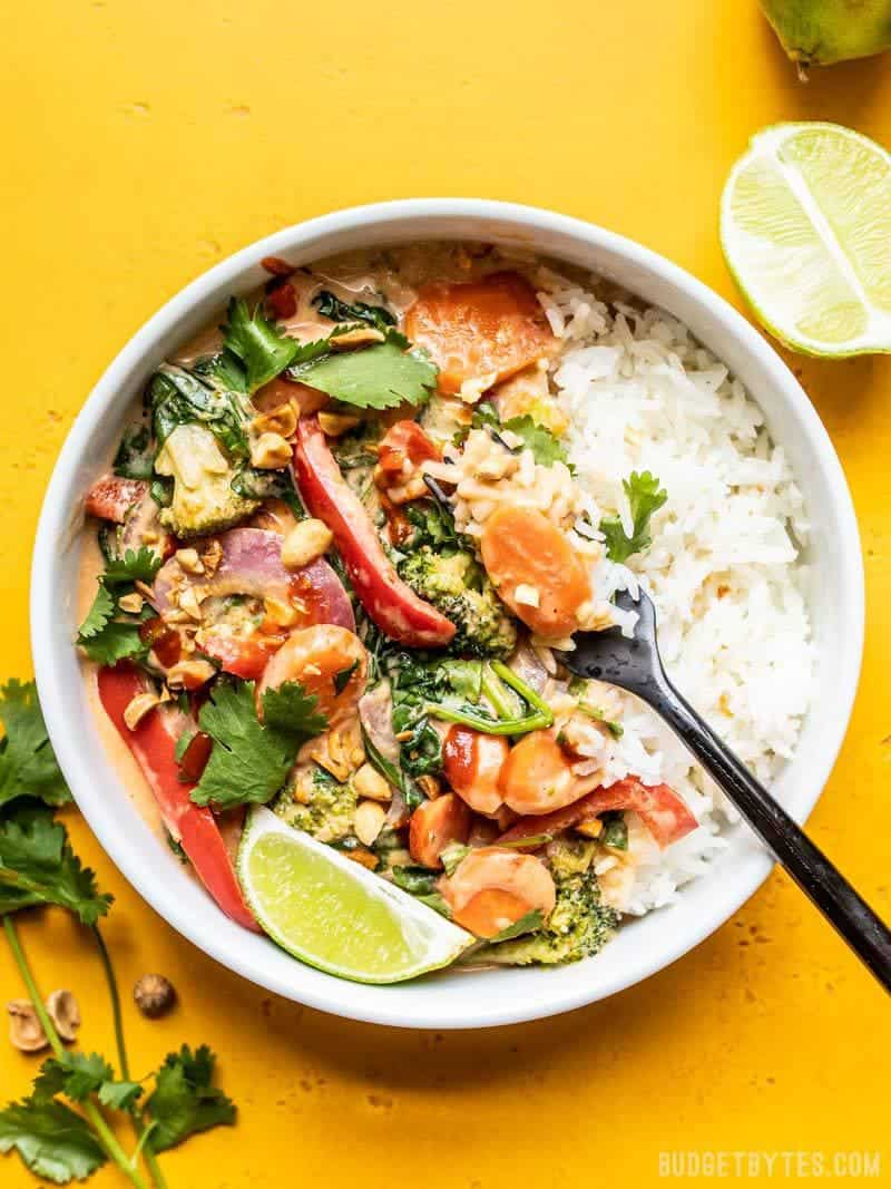 Big bowl of Spicy Coconut Vegetable Stir Fry with lime wedge