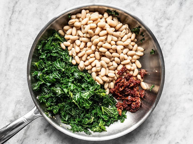 Add Cannellini Beans and Sun Dried Tomatoes to Skillet