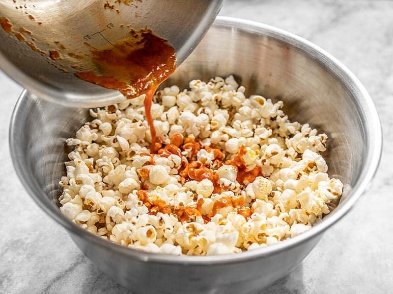 Drizzle sriracha butter over popcorn