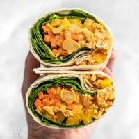 A Sriracha Chickpea Salad Wrap cut open, with open sides facing viewer.