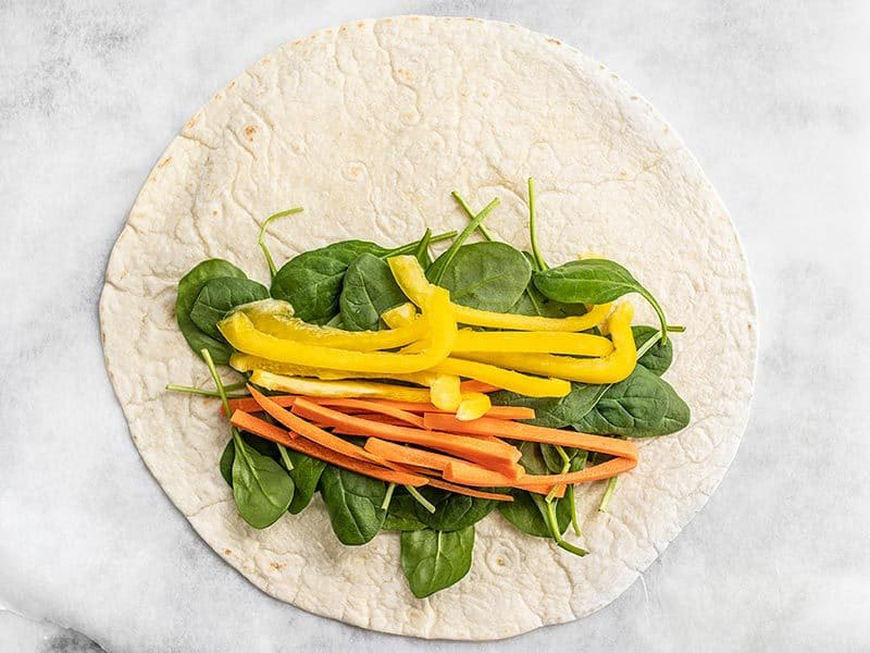 Vegetables on Tortilla for Sriracha Chickpea Salad Wraps