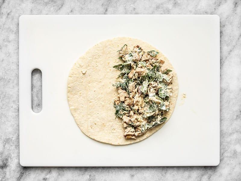 Quesadilla filling covering half of a tortilla