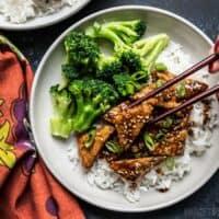 Sesame Tempeh Bowls being eaten with chopsticks