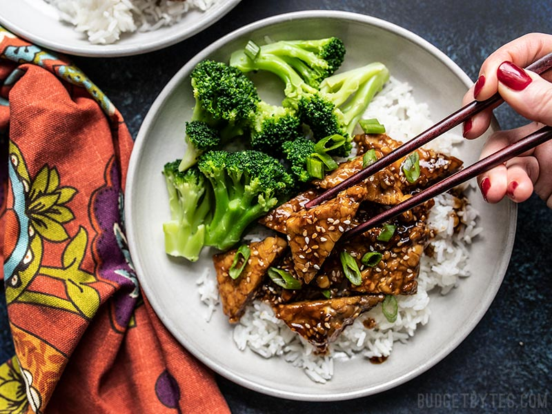 Sesame Tempeh Bowls being eaten with chopsticks