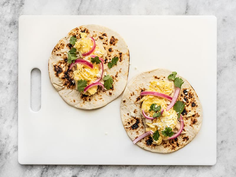 Add Cilantro, Pickled Red Onion, and a pinch of Crumbled Cheese