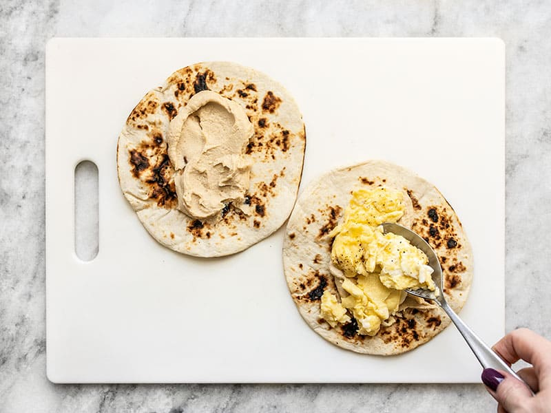Add Hummus and Scrambled Eggs to Toasted Tortillas