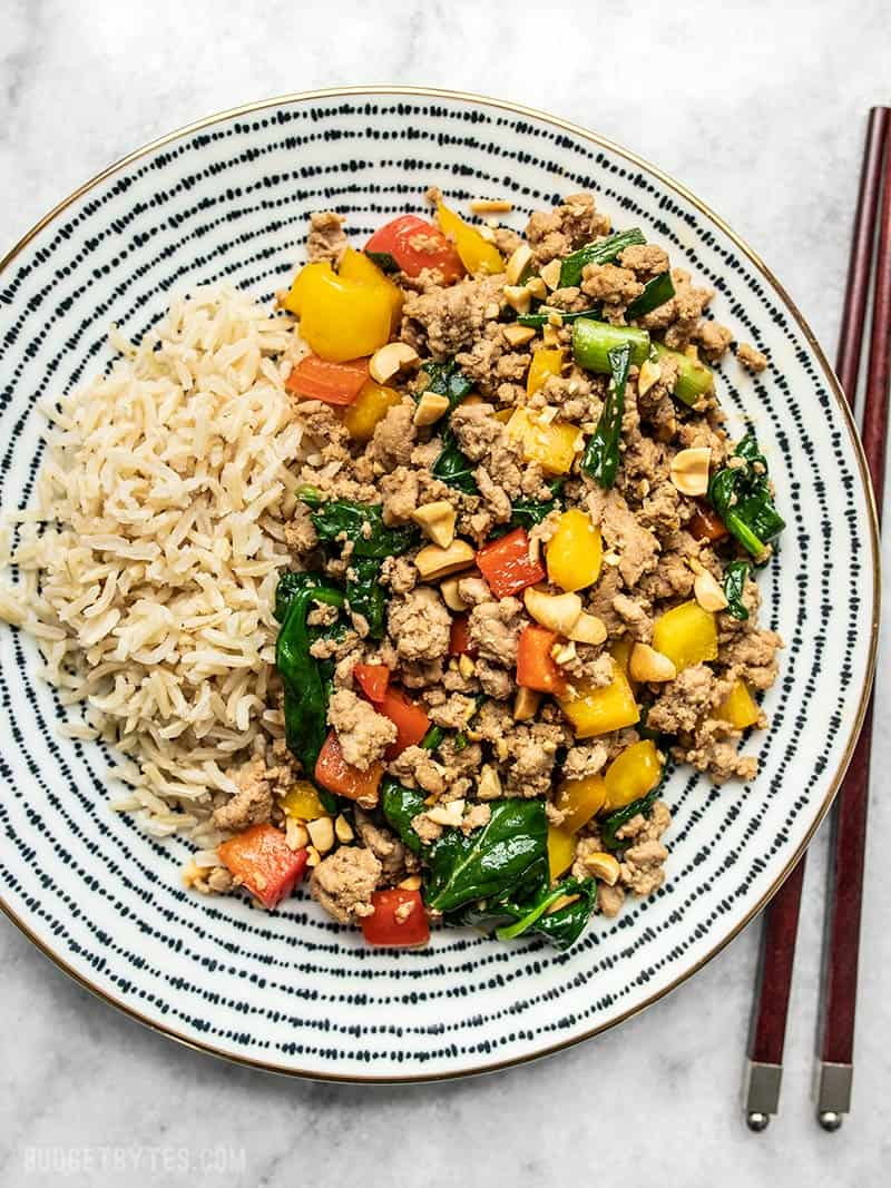 A patterned plate full of Ground Turkey Stir Fry and brown rice.