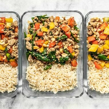 Three rectangular glass meal prep containers with Ground Turkey Stir Fry and Brown Rice