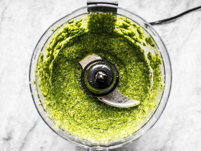 Processed parsley pesto pasta with oil in the food processor