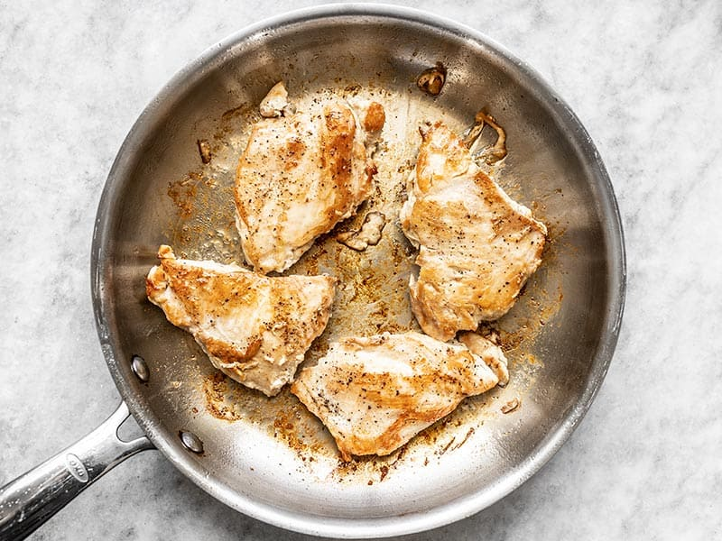 Browned Chicken Breasts in the skillet
