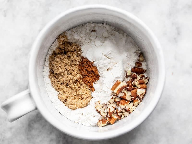 Dry ingredients for cinnamon nut swirl mug cake in a mug