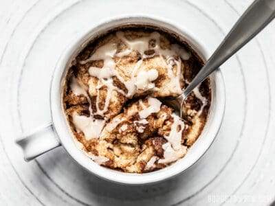 Overhead view of a spoon dug into a Cinnamon Nut Swirl Mug Cake