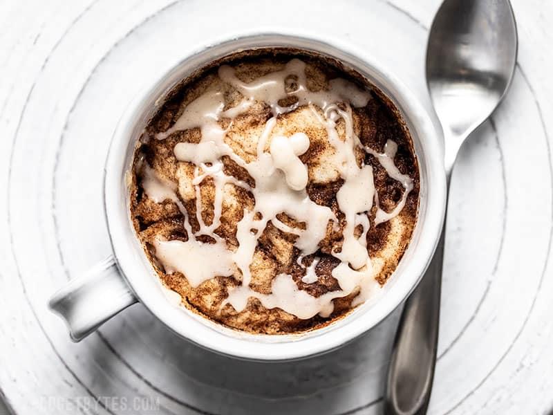 Finished Cinnamon Nut Swirl Mug Cake with icing