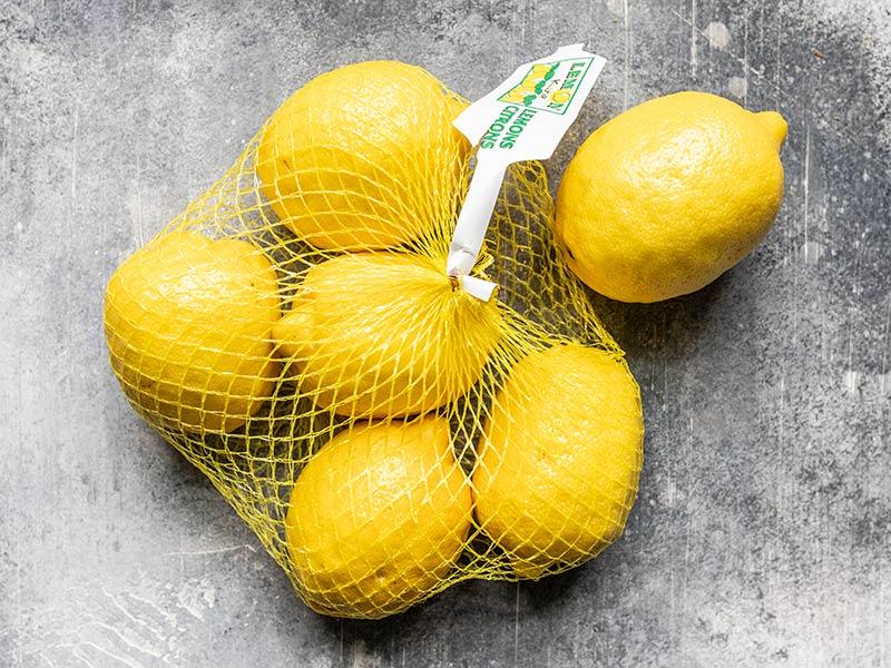 Fresh lemons in a mesh bag
