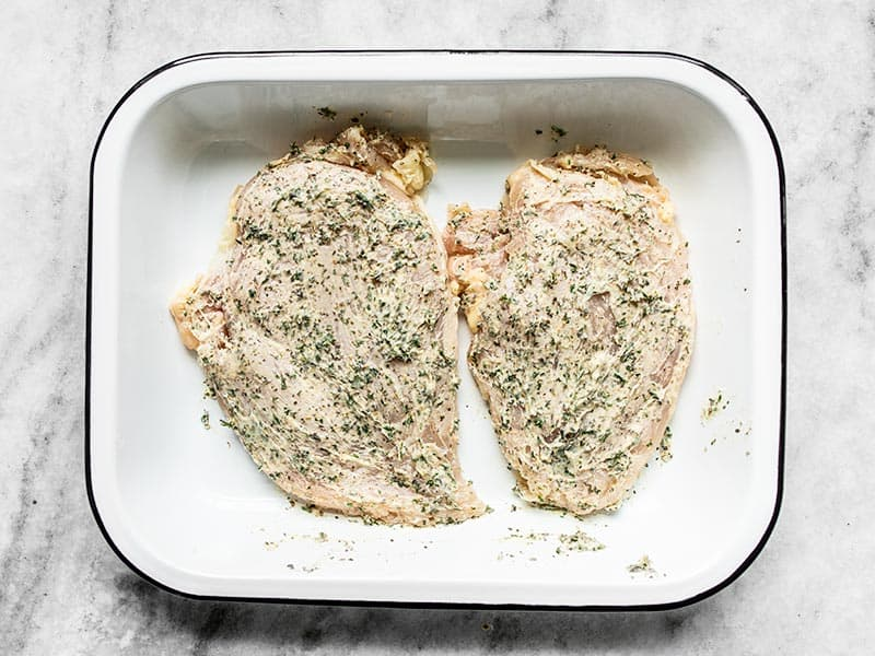 Garlic Herb Chicken Breast in a baking dish ready to go into the oven.