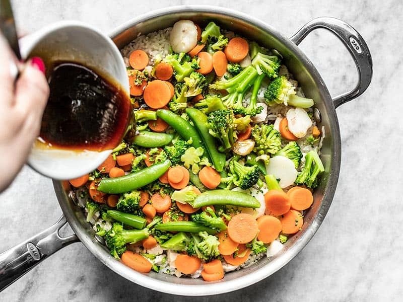 Add Teriyaki Sauce to Steamed Vegetables and Rice