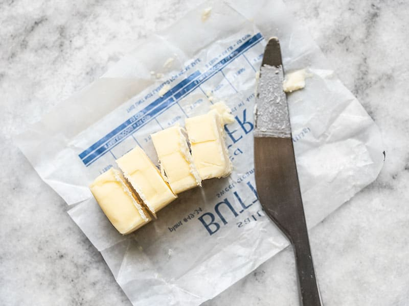 Slice Butter into 1 Tbsp pieces