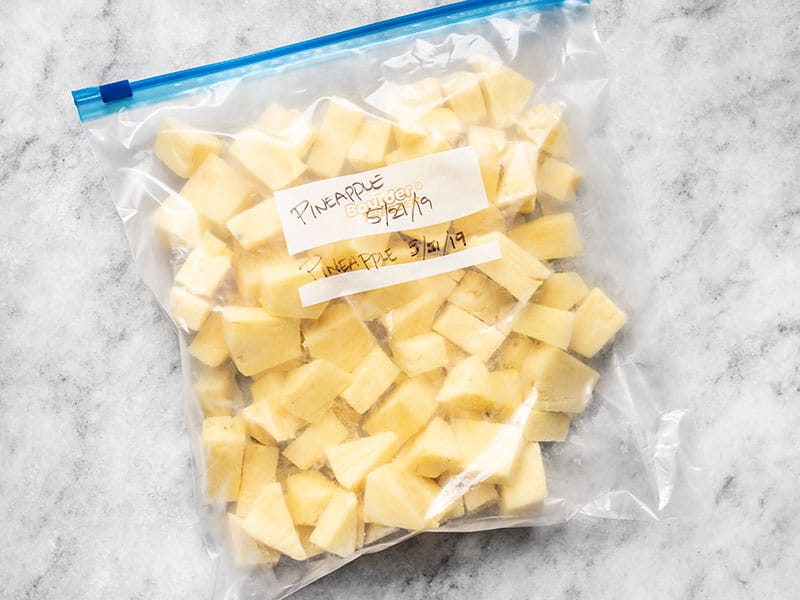 Frozen Pineapple Chunks in a gallon-sized freezer bag.