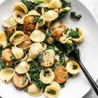 Overhead view of a shallow bowl full of Spicy Orecchiette with Chicken Sausage and Kale