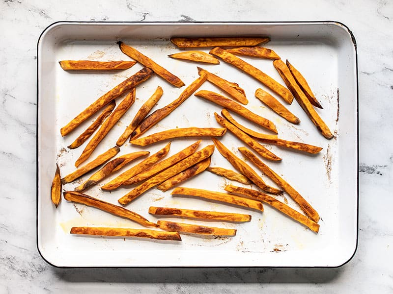 Baked sweet potato fries on the baking sheet