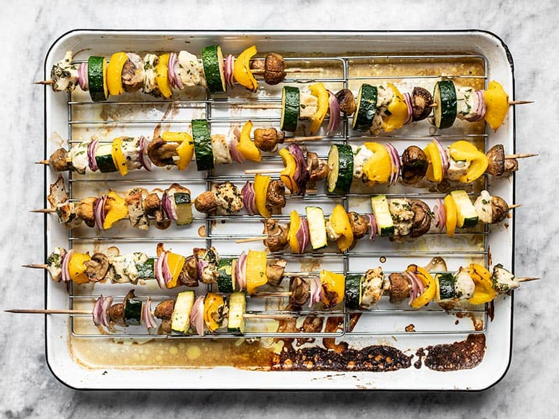 Broiled kebabs on the baking sheet.