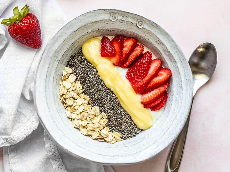 Close up of a Lemon Berry Yogurt Breakfast Bowl, unstirred.