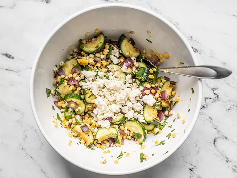 Add crumbled feta to salad