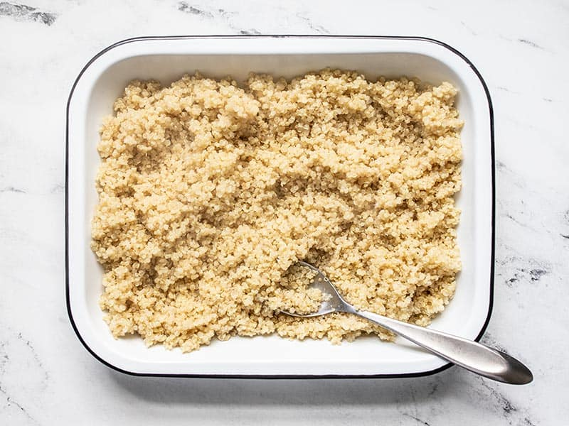 Spread out quinoa in a dish to cool