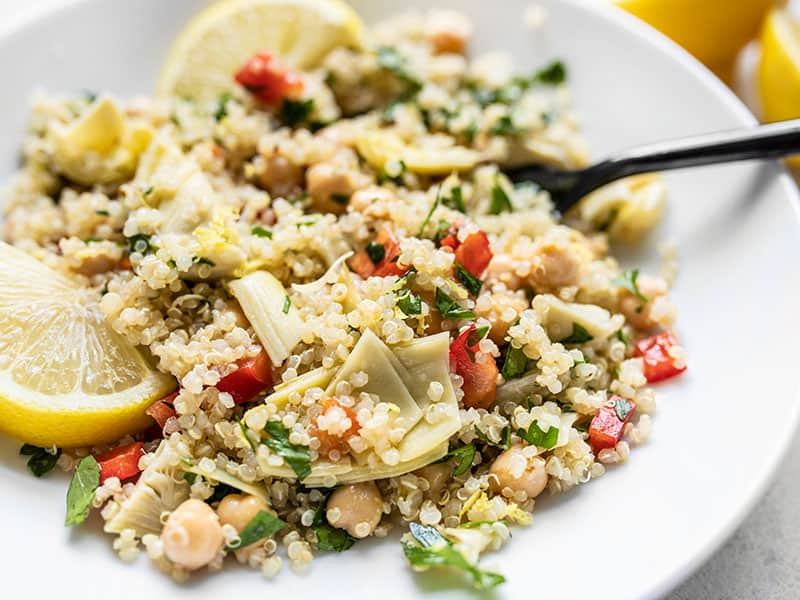 Close up side view of Lemony Artichoke and Quinoa Salad in a bowl