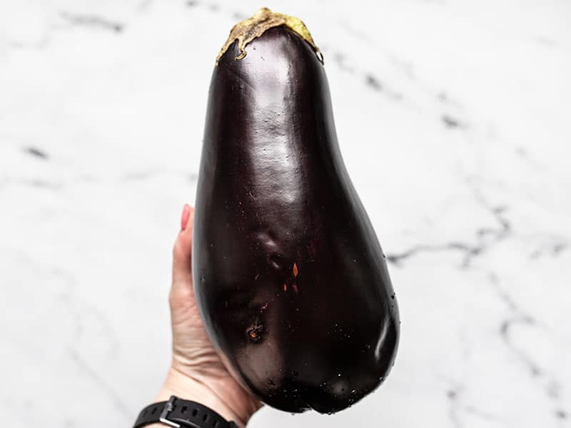 Eggplant in hand for size