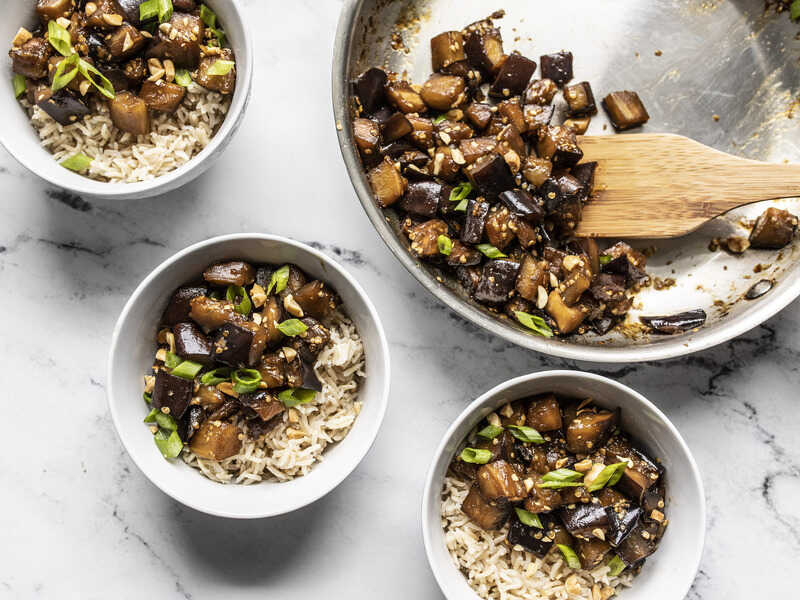 Soy Glazed Eggplant being served from the skillet into three bowls