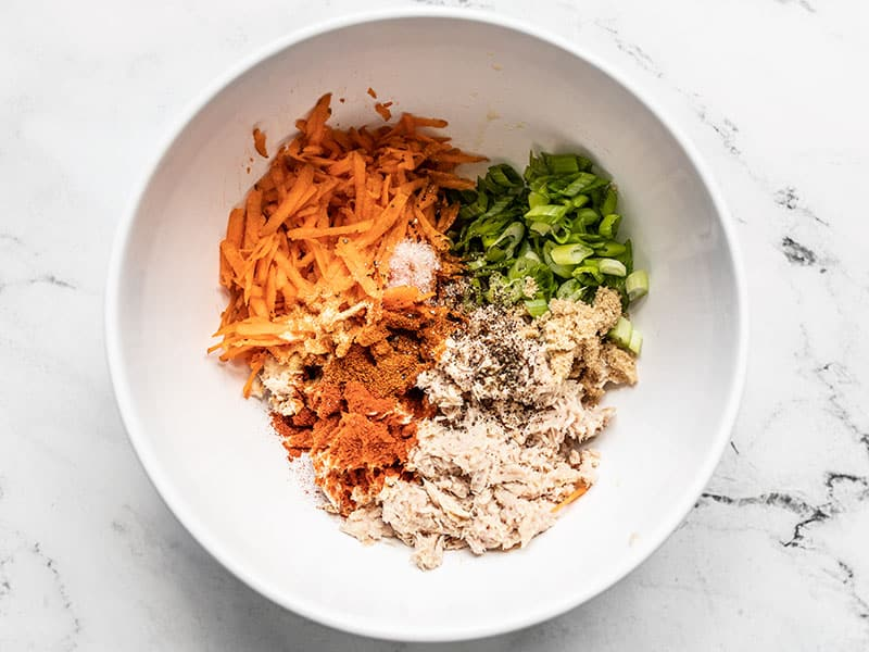 Ingredients for Sweet and Spicy Tuna Salad in a bowl, unmixed