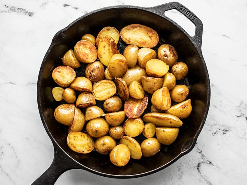 Crispy fried potatoes in a cast iron skillet