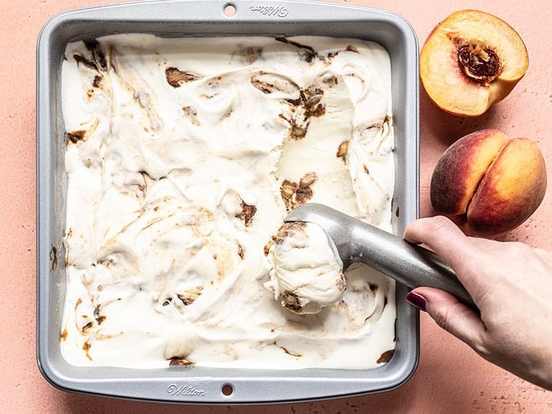No Churn Balsamic Peach Ice Cream being scooped out of the freezer dish.