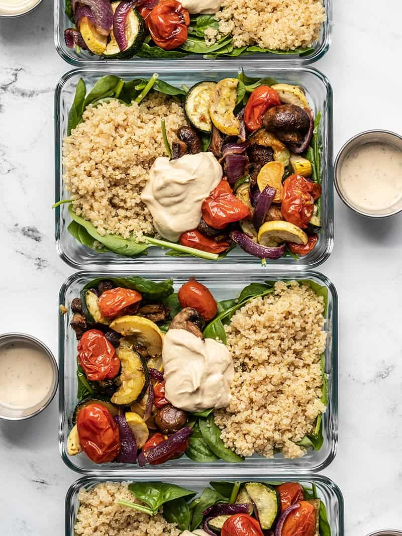 Glass meal prep containers with Roasted Vegetable Salad in a row.