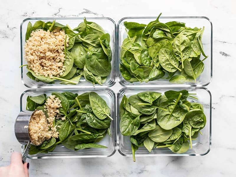 Add spinach and quinoa to meal prep containers