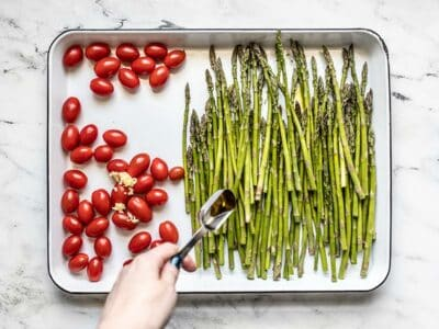 Asparagus and Tomatoes on the baking sheet