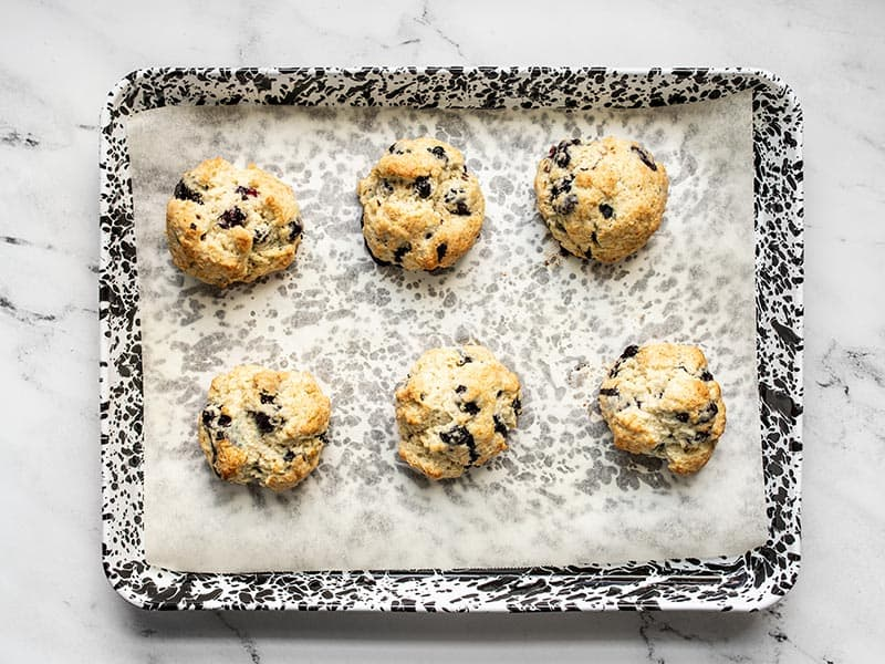 Baked blueberry biscuits on the baking sheet