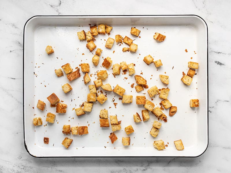 Baked homemade croutons on the baking sheet