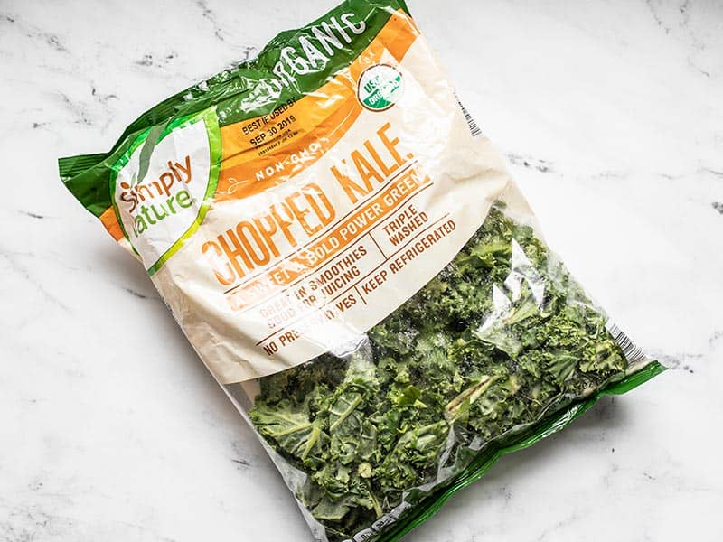 Bag of torn kale leaves