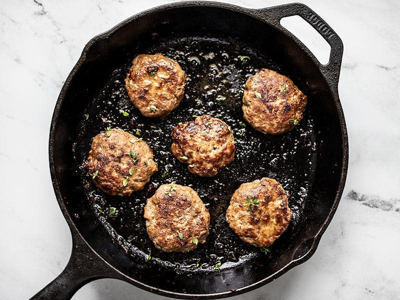 Cooked Maple Sage Breakfast Sausage in a cast iron skillet
