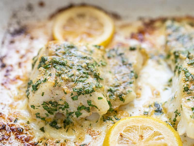 Close up view of the baked Garlic Butter Cod in the baking dish.