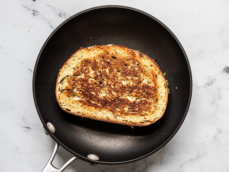 Cooked Pesto Grilled Cheese in the skillet