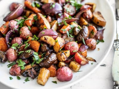 Close up of Balsamic Roasted Vegetables on a white platter