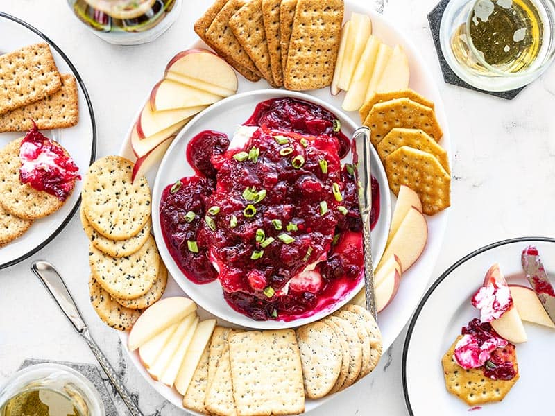 Cranberry Cream Cheese Dip platter with crackers and apple slices