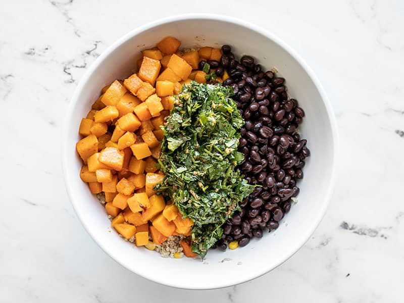 Butternut squash black beans and dressing in bowl