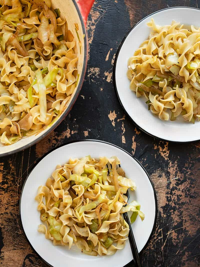 Fried Cabbage and Noodles in a large pot, served onto two white plates